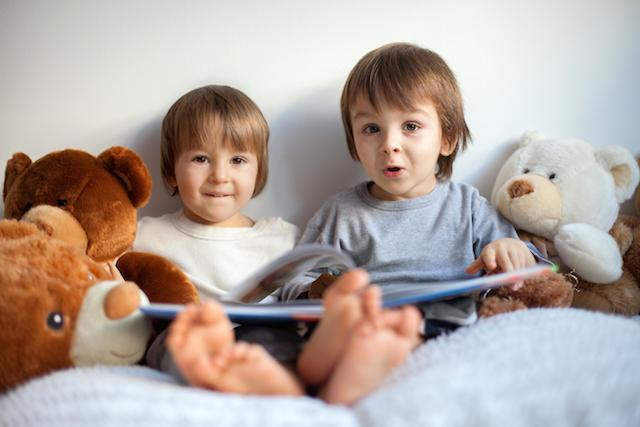 Young kids reading a book | Children's Dentist White Bear Lake MN
