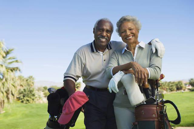 couple golfing | Dental Implants in White Bear Lake MN | White Bear Smiles