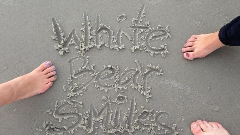 White Bear Smiles spelled in the sand | Dentist in White Bear Lake MN | White Bear Smiles