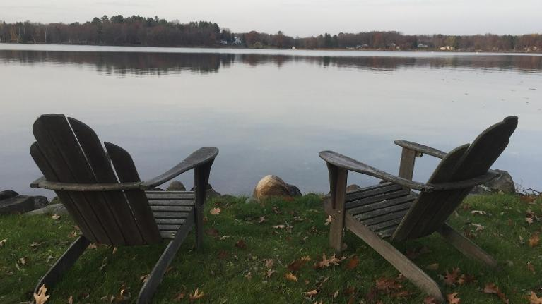 Two chairs on the edge of a lake in White Bear Lake MN