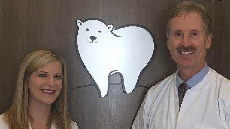 Dr/ Anderson nest to White Bear Smiles logo | Dentist in White Bear Lake MN | White Bear Smiles