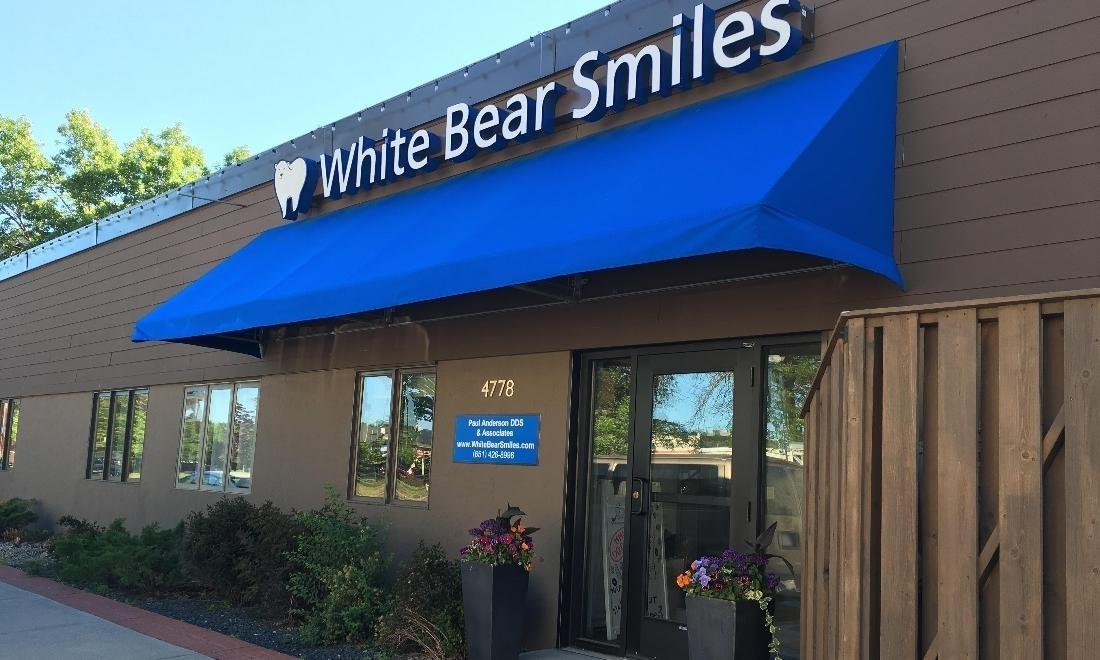 The exterior of White Bear Smiles | Blue awning in White Bear Lake, MN