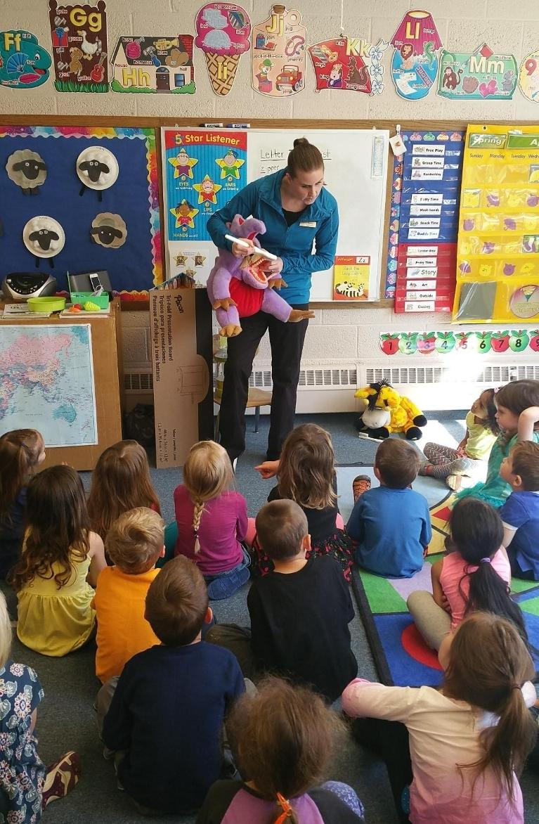 A hygienist from White Bear Smiles gives a presentation to a preschool group
