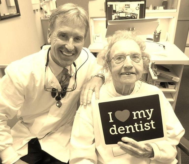 Dr Paul Anderson with a happy dental patient in White Bear Lake MN